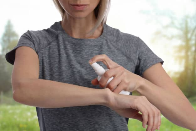 Woman-spraying-insect-repellent-on-skin-outdoor-Eucalyptus-Oil-Uses-getty.jpg